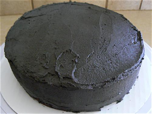 Round Cake Decorated with Black Colored Icing