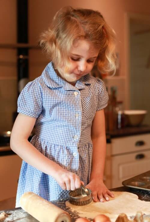 Little Girl Cutting Out Cookies