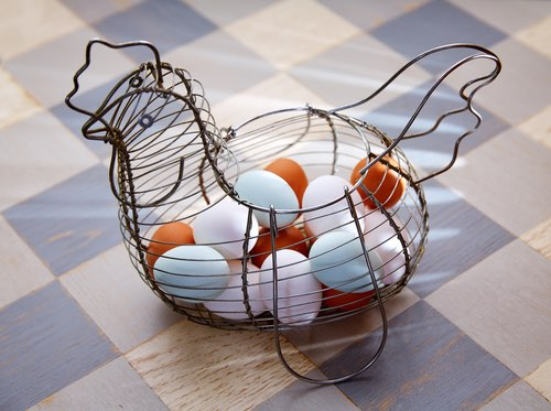White and Brown Eggs in a Vintage Egg Basket