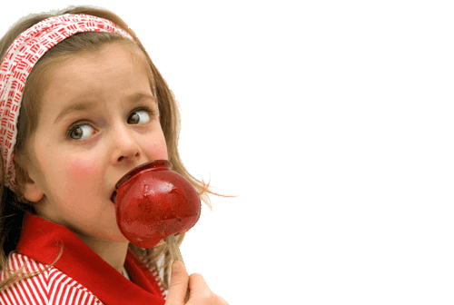 Young Girl Eating a Homemade Red Candy Apple