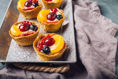 Homemade Fruit Tarts with Berries and Slices Set in a Plain Baking Pan