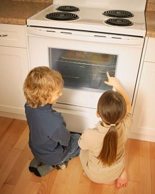 Kids Watching Cookies Baking in the Oven