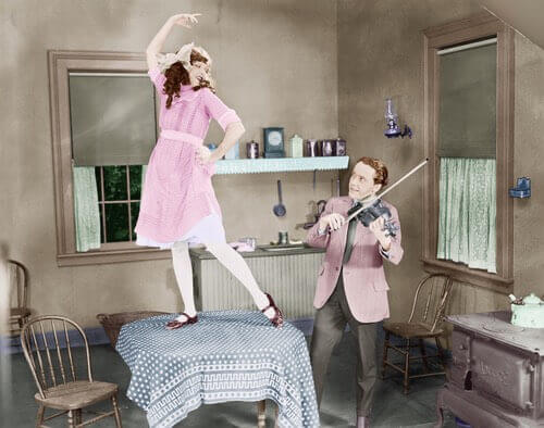 Vintage Photo Illustration of a Lady Dancing on a Table in an Old Fashioned Kitchen