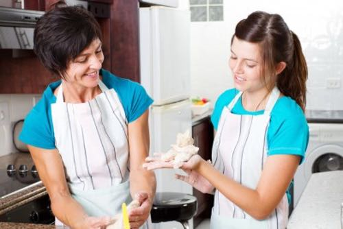 Mother Showing Daughter How to Make Cookies