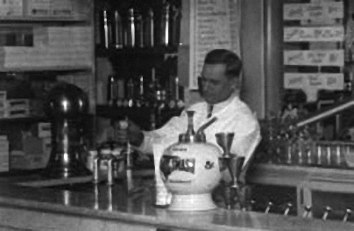 Old Time Soda Jerk Adding Fountain Syrup to a Soda Beverage