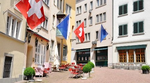 Enjoy Traditional Swiss Desserts At An Outdoor Cafe