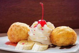 Balls of Deep Fried Ice Cream with Sauces and Whipped Cream