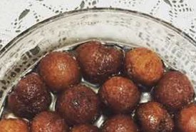 Indian Gulab Jamuns Frosted in Sugar Syrup