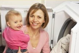 Mother and Baby Removing Laundry Items