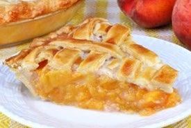 Slice of Peach Pie with a Lattice Crust Top