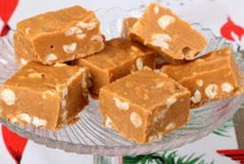Pieces of Peanut Butter Fudge on a Glass Candy Stand