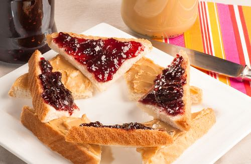 Triangular Sweet Sandwiches of Peanut Butter and Homemade Jam