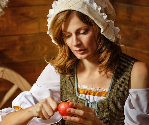 Girl Peeling an Apple