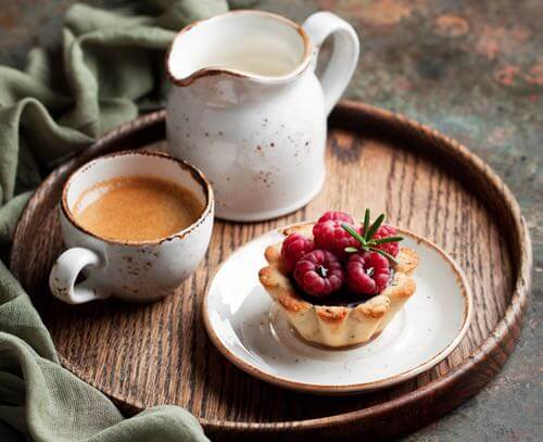 Raspberry Tartlet with a Cup of Tea Served on a Tray