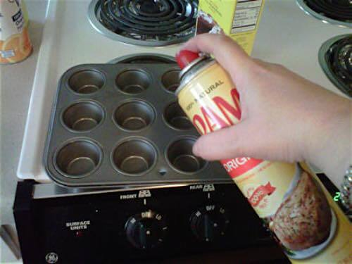 Spray Muffin Pans with Oil