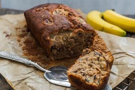 Banana Bread Fresh from the Oven with a Cut Slice