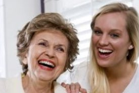Mother and Her Daughter Laughing Together