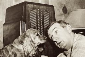 Man and His Dog Companion Listen to a Vintage Radio Set
