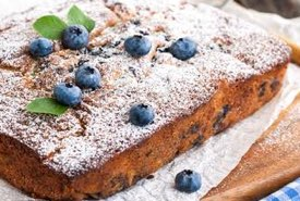 Blueberry Cake Topped with Powdered Sugar