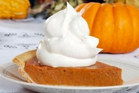 Slice of Pumpkin Pie with a Whipped Cream Topping